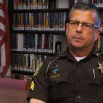 A Menominee County Sherriff's Deputy stands mute in court.